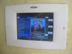 Noah RTI in-wall automation touchscreen with movie server